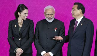 From left, New Zealand Prime Minister Jacinda Ardern, Indian Prime Minister Narendra Modi, Chinese Premier Li Keqiang talk before a group photo at The Regional Comprehensive Economic Partnership Association of Southeast Asian Nations (ASEAN) summit in Nonthaburi, Thailand, Monday, Nov. 4, 2019. (AP Photo/Wason Wanichakorn)