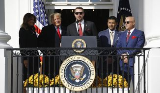 Washington Nationals starting pitcher Max Scherzer, center, speaks as first lady Melania Trump, from left, President Donald Trump, manager Dave Martinez and general manager Mike Rizzo listen, during an event to honor the 2019 World Series champion Nationals baseball team at the White House, Monday, Nov. 4, 2019, in Washington. (AP Photo/Patrick Semansky)