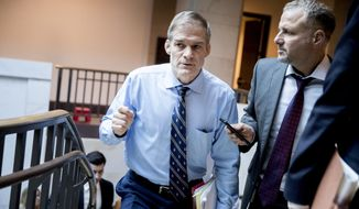 Rep. Jim Jordan, R-Ohio, speaks to a reporter as he leaves a closed door area where the ongoing House impeachment inquiry into President Donald Trump are conducted on Capitol Hill in Washington, Monday, Nov. 4, 2019. (AP Photo/Andrew Harnik)