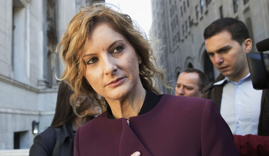 In this Oct. 18, 2018, file photo, Summer Zervos leaves New York state appellate court in New York. (AP Photo/Mary Altaffer, File)