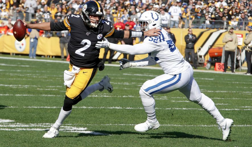 Pittsburgh Steelers quarterback Mason Rudolph (2) scrambles away from Indianapolis Colts defensive end Ben Banogu (52) in the first half of an NFL football game , Sunday, Nov. 3, 2019, in Pittsburgh. (AP Photo/Gene J. Puskar)
