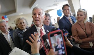 """Louisiana's Republican gubernatorial candidate Eddie Rispone talks to media on a campaign stop at New Orleans International Airport in Kenner, La., Monday, Nov. 4, 2019. Rispone says a radio ad linking him and President Donald Trump to former Ku Klux Klan leader David Duke is """"disgusting."""" Rispone is blaming Democratic incumbent John Bel Edwards for the advertising by the New Orleans-based Black Organization for Leadership Development. There's no evidence Edwards is connected to the effort. (AP Photo/Gerald Herbert)"""