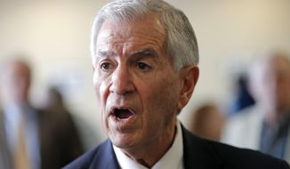 """Louisiana's Republican gubernatorial candidate Eddie Rispone greets supporters and talks to media on a campaign stop at New Orleans International Airport in Kenner, La., Monday, Nov. 4, 2019. Rispone says a radio ad linking him and President Donald Trump to former Ku Klux Klan leader David Duke is """"disgusting."""" Rispone is blaming Democratic incumbent John Bel Edwards for the advertising by the New Orleans-based Black Organization for Leadership Development. There's no evidence Edwards is connected to the effort. (AP Photo/Gerald Herbert)"""