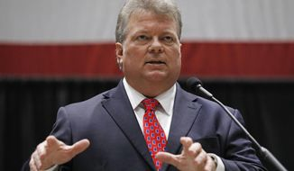 "Democratic nominee for governor, Attorney General Jim Hood, addresses business leaders at the Mississippi Economic Council's annual ""Hobnob Mississippi,"" in Jackson, Miss., Thursday, Oct. 31, 2019. The social event is hosted by the state chamber of commerce and is one of the last big political gatherings before the Nov. 5 elections. (AP Photo/Rogelio V. Solis)"