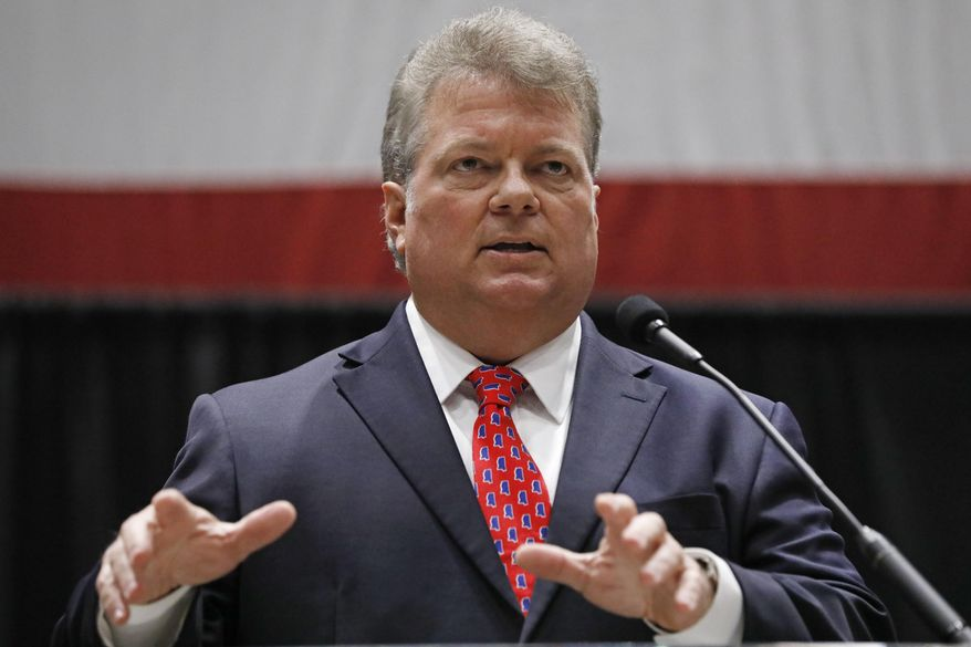 """Democratic nominee for governor, Attorney General Jim Hood, addresses business leaders at the Mississippi Economic Council's annual """"Hobnob Mississippi,"""" in Jackson, Miss., Thursday, Oct. 31, 2019. The social event is hosted by the state chamber of commerce and is one of the last big political gatherings before the Nov. 5 elections. (AP Photo/Rogelio V. Solis)"""