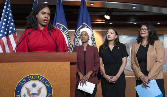 """In this July 15, 2019 file photo, from left, Rep. Ayanna Pressley, D-Mass., Rep. Ilhan Omar, D-Minn., Rep. Alexandria Ocasio-Cortez, D-N.Y., and Rep. Rashida Tlaib, D-Mich., respond during a news conference at the Capitol in Washington, to remarks by President Donald Trump after his call for the four Democratic congresswomen to go back to their """"broken"""" countries. All are American citizens. Pressley, the only one of the four who has yet to back any of the Democrats seeking the party's nomination for president in 2020, told the Associated Press, Monday, Nov. 4, that several top party candidates are seeking her endorsement. (AP Photo/J. Scott Applewhite) **FILE**"""