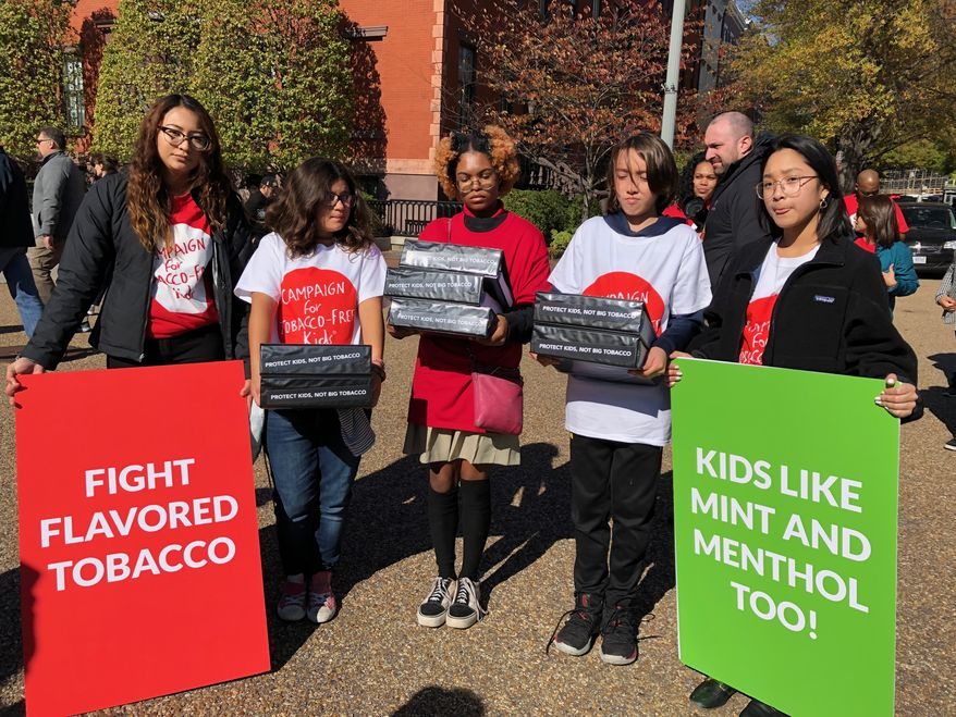 Youth advocates for the Campaign for Tobacco-Free Kids tried to deliver a petition to the White House on Nov. 4 asking President Trump to stay strong on his commitment to remove all e-cigarette flavors, including mint and menthol. (Shen Wu Tan/The Washington Times)