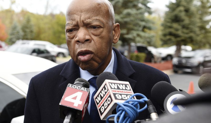 U.S. Rep. John Lewis, a friend of John Conyers Jr., talks about the life and good work of the late Congressman before he enters the church for the funeral at Greater Grace Temple in Detroit on Monday, November 4, 2019.  (Clarence Tabb Jr./Detroit News via AP)
