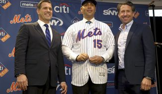 The new New York Mets manager, Carlos Beltran, center, poses for a picture with general manager Brodie Van Wagenen, left, and Mets COO Jeff Wilpon during a baseball news conference at Citi Field, Monday, Nov. 4, 2019, in New York. Beltran, two years removed from his playing career and with no managerial experience, has been picked by the Mets to replace Mickey Callaway. (AP Photo/Seth Wenig) ** FILE **