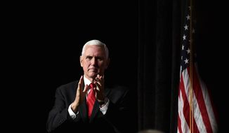 Vice President Mike Pence applauds at Mississippi Republican Gubernatorial Candidate Tate Reeves' Rally at the Mississippi Coast Coliseum and Convention Center in Biloxi, Miss Monday, Nov. 4, 2019. (Cam Bonelli/Hattiesburg American via AP)
