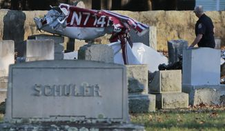 New Bedford fire and police work the scene of a crashed plane at Rural Cemetery in New Bedford, Mass., Monday, Nov. 4, 2019. It's not clear what caused the plane to crash and if anyone was injured. No further information was posted. (Peter Pereira/Standard Times via AP)