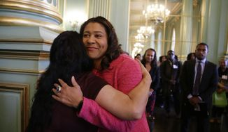 In this photo taken Friday, Nov. 1, 2019, San Francisco Mayor London Breed is embraced before speaking at the annual Women In Construction Expo in San Francisco. San Francisco's mayor faces easy re-election in Tuesday's election but a hefty list of problems to solve, including a homelessness crisis, drug epidemic and a housing shortfall. The former president of the Board of Supervisors narrowly won a special June 2018 election to fill the seat left vacant by the sudden death of Mayor Ed Lee. (AP Photo/Eric Risberg)