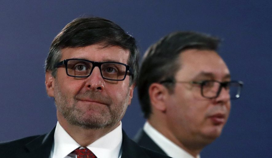 Matthew Palmer, Deputy Assistant Secretary of the U.S.Department of State - Bureau of European and Eurasian Affairs, left, and Serbian President Aleksandar Vucic arrive for a news conference after their meeting in Belgrade, Serbia, Monday, Nov. 4, 2019. The U.S. has intensified efforts to help relaunch stalled talks on normalizing relations between Serbia and Kosovo, a former province whose 2008 declaration of independence Belgrade does not recognize. (AP Photo/Darko Vojinovic)