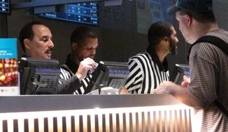 In this Sept. 5, 2019 photo, a gambler makes a sports bet at Bally's casino in Atlantic City N.J. on the first night of the new National Football League season. On Monday Nov. 4, 2019, panelists at a sports betting forum in New York City estimated that sports betting will become a $7 billion to $8 billion market in the U.S. by 2025. (AP Photo/Wayne Parry)