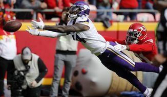 Minnesota Vikings wide receiver Stefon Diggs (14) can't reach an overthrown pass as Kansas City Chiefs cornerback Bashaud Breeland (21) defends, during the first half of an NFL football game in Kansas City, Mo., Sunday, Nov. 3, 2019. (AP Photo/Colin E. Braley)