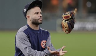 Houston Astros' Jose Altuve flips his glove during batting practice before Game 7 of the baseball World Series against the Washington Nationals Wednesday, Oct. 30, 2019, in Houston. (AP Photo/David J. Phillip)