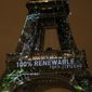 An artwork entitled 'One Heart One Tree' by artist Naziha Mestaoui is displayed on the Eiffel tower ahead of the 2015 Paris Climate Conference, in Paris, Sunday, Nov. 29, 2015. U.N. Secretary-General Ban Ki-moon will launch two weeks of climate talks starting Monday aiming at a long-term global agreement for all countries to reduce man-made emissions that heat the planet. (AP Photo/Thibault Camus)
