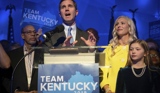 Kentucky Attorney General and democratic Gubernatorial Candidate Andy Beshear stands with his wife, Britainy as he delivers a speech at the Kentucky Democratic Party election night watch party, Tuesday, Nov. 5, 2019, in Louisville, Ky. (AP Photo/Bryan Woolston)