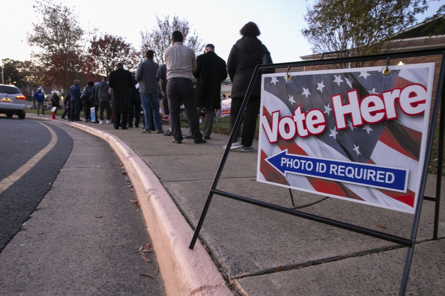 Voters wait in line to get into the polling station at Hampton Oaks Elementary School in Stafford, Va., Tuesday, Nov. 5, 2019. (Mike Morones/The Free Lance-Star via AP)