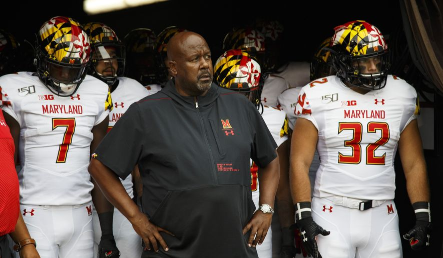 In this Sept. 14, 2019, file photo, Maryland head coach Michael Locksley, center, looks on as he is about to lead his team out of the tunnel for the first half of an NCAA college football against Temple, in Philadelphia. One year ago, Maryland took Ohio State into overtime before a failed 2-point conversion resulted in a 52-51 defeat. In the rematch Saturday, the Terrapins are a 43-point underdog. (AP Photo/Chris Szagola, File) **FILE**
