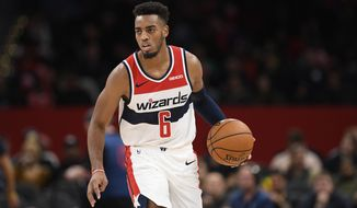 Washington Wizards guard Troy Brown Jr. (6) dribbles the ball during the second half of an NBA basketball game against the Detroit Pistons, Monday, Nov. 4, 2019, in Washington. The Wizards won 115-99. (AP Photo/Nick Wass)