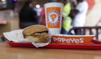 In this Aug. 22, 2019, photo, a chicken sandwich is seen at a Popeyes as guests wait in line, in Kyle, Texas. Police in Maryland say a man fatally stabbed another customer outside a Popeyes restaurant in a fight over the recently rereleased chicken sandwich. Police in Maryland say a man fatally stabbed another customer at a Popeyes restaurant in a fight over the recently rereleased chicken sandwich. A Prince Georges County police spokeswoman told news outlets the two men were waiting in line at an Oxon Hill Popeyes Monday night, Nov. 4, 2019, when one of the men accused the other of cutting in front of him in a line specifically for ordering sandwiches. Police say the fight spilled outside where a 28-year-old was fatally stabbed. (AP Photo/Eric Gay)