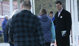 Paul Milde, the Republican candidate for the House of Delegates 28th District, greets at Ferry Farm Elementary School on Election Day in Stafford, Va., Tuesday, Nov. 5, 2019. (Mike Morones/The Free Lance-Star via AP)
