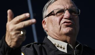 FILE - In this Jan. 9, 2013, file photo, Maricopa County Sheriff Joe Arpaio speaks with the media in Phoenix. Documents obtained by The Associated Press show a court-appointed investigator concluded that high-ranking managers for former metro Phoenix Sheriff Arpaio disregarded a federal judge's order to halt immigration sweeps targeting Latinos. (AP Photo/Ross D. Franklin, File)