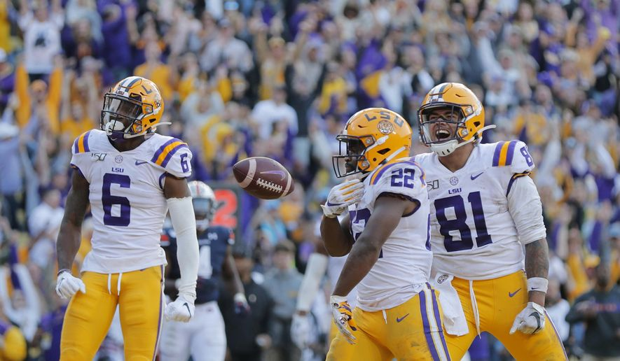 LSU running back Clyde Edwards-Helaire (22) celebrates his touchdown with tight end Thaddeus Moss (81) and wide receiver Terrace Marshall Jr. (6) in the second half of an NCAA college football game against Auburn in Baton Rouge, La., Saturday, Oct. 26, 2019. LSU won 23-20. (AP Photo/Gerald Herbert) **FILE**