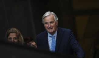 European Union chief Brexit negotiator Michel Barnier rides an escalator on his way to a meeting about Brexit outside the EU headquarters in Brussels, Friday, Oct. 25, 2019. European Union ambassadors are meeting in Brussels Friday to discuss what kind of extension to the Brexit deadline they could propose to Britain. (AP Photo/Francisco Seco)