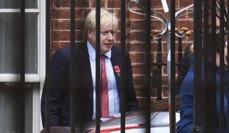 Britain's Prime Minister Boris Johnson leaves Downing Street in London, Monday, Nov. 4, 2019. (Dominic Lipinski/PAvia AP)