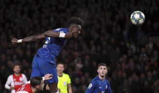 Chelsea's Tammy Abraham heads the ball during the Champions League, group H, soccer match between Chelsea and Ajax, at Stamford Bridge in London, Tuesday, Nov. 5, 2019. (AP Photo/Ian Walton)