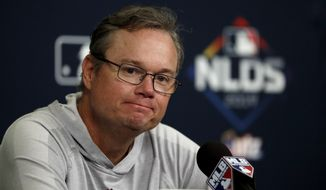FILE - In this Oct. 5, 2019 file photo St. Louis Cardinals manager Mike Shildt listens to a question during a news conference at the baseball National League Division Series in St. Louis. Shildt has been given a new three-year contract through the 2022 season. Shildt was hired in 2018 and his initial deal ran through 2020. (AP Photo/Jeff Roberson, file)