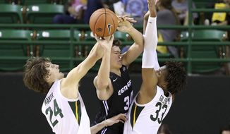 Central Arkansas guard Jaxson Baker (34) tries to pass the ball between Baylor guard Matthew Mayer (24) and forward Freddie Gillespie (33) during the first half of an NCAA college basketball game Tuesday, Nov. 5, 2019, in Waco, Texas. (AP photo/ Jerry Larson)