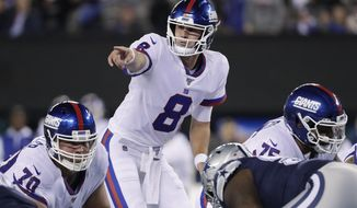 New York Giants quarterback Daniel Jones (8) calls an audible at the line of scrimmage during the first quarter of an NFL football game against the Dallas Cowboys, Monday, Nov. 4, 2019, in East Rutherford, N.J. (AP Photo/Adam Hunger)