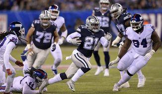 Dallas Cowboys running back Ezekiel Elliott (21) runs the ball against the New York Giants during the first quarter of an NFL football game, Monday, Nov. 4, 2019, in East Rutherford, N.J. (AP Photo/Bill Kostroun)