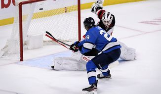 New Jersey Devils goaltender Mackenzie Blackwood (29) makes a save on Winnipeg Jets' Patrik Laine (29) during the shoot-out in an NHL hockey game, Tuesday, Nov. 5, 2019 in Winnipeg, Manitoba. (Fred Greenslade/Canadian Press via AP)