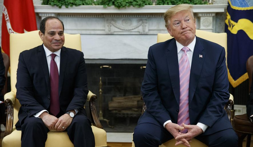 "FILE - In this April 9, 2019 file photo, President Donald Trump meets with Egyptian President Abdel Fattah el-Sisi in the Oval Office of the White House in Washington. El-Sissi thanked Trump late Monday, Nov. 4,  for his ""generous concern"" for helping revive Egypt's deadlocked dispute with Ethiopia over its construction of a massive upstream Nile dam. (AP Photo/Evan Vucci, File)"