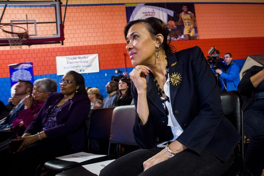 FILE - In this Friday, March 22, 2019, file photo, Flint Mayor Karen Weaver listens during a presentation and announcement by tech billionaire Elon Musk at Doyle-Ryder Elementary School in Flint, Mich. Weaver faces off Tuesday, Nov. 5, 2019, against Sheldon Neeley, a state representative and former city councilman, in the city's mayoral race. (Jake May/The Flint Journal via AP, File)