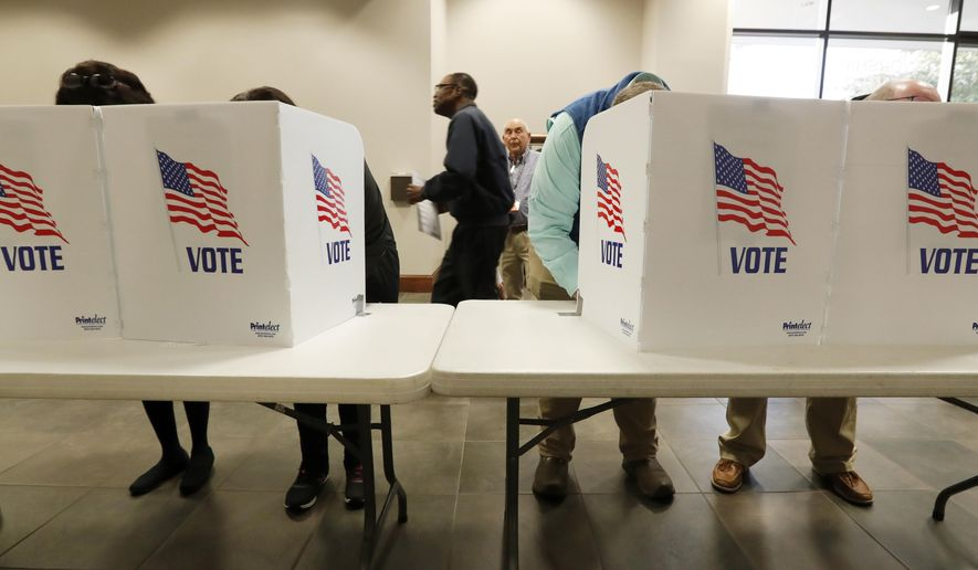 Voters cast their choices in their individual kiosks at this Ridgeland, Miss., precinct Tuesday, Nov. 5, 2019. Registered voters are having their say in Mississippi's most hotly contested governor's race since 2003 and are also selecting six other statewide officials and deciding a host of legislative and local offices. (AP Photo/Rogelio V. Solis)