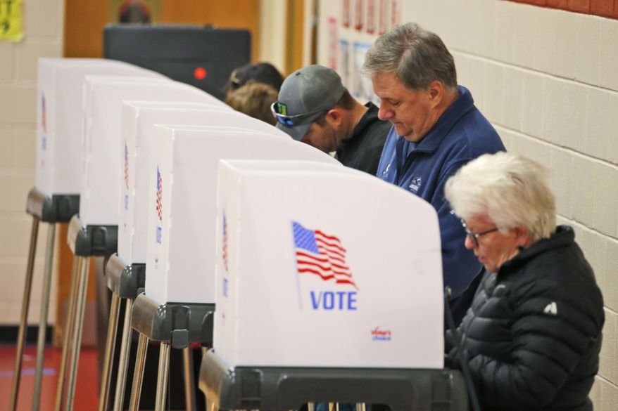 Voters cast their ballots at a polling station in Richmond, Va., Tuesday, Nov. 5, 2019. All seats in the Virginia House of Delegates and State Senate are up for election. (AP Photo/Steve Helber) **FILE**
