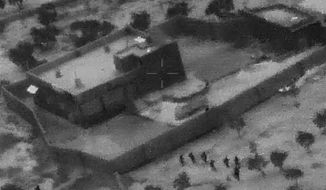 This Oct. 26, 2019, file image from video released by the Department of Defense, and displayed at a Pentagon briefing, shows U.S. Special Forces, figures at lower right, moving toward compound of Islamic State leader Abu Bakr al-Baghdadi.(Department of Defense via AP, File)