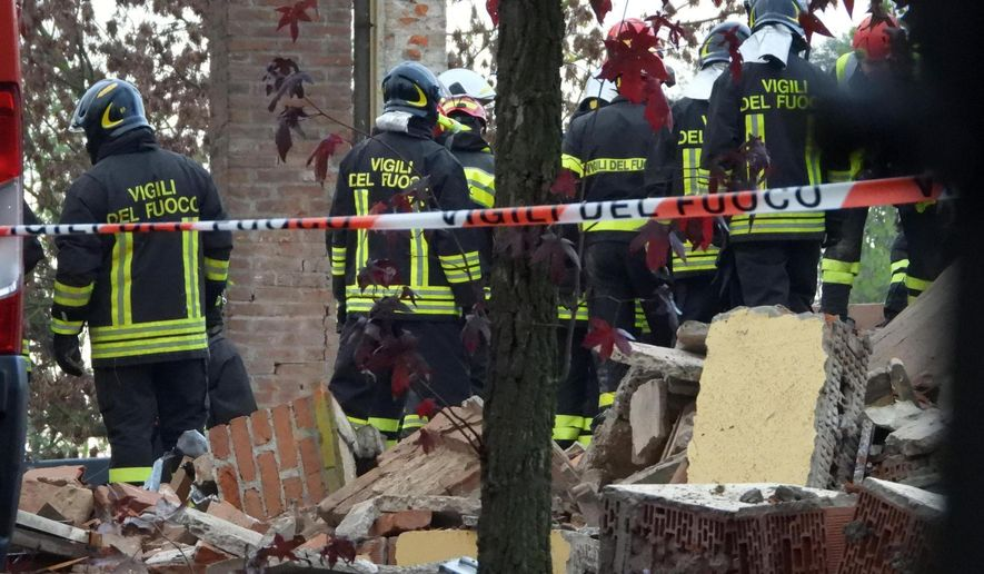 Firefighters search among debris following an explosion in a building in Quargnento, Northern Italy, Tuesday, Nov. 5, 2019. Sky TG24 reported that firefighters were responding to a report of an explosion in a disused section of a farm building in Alessandria province when a second, stronger explosion occurred early Tuesday, killing three firefighters. (Dino Ferretti/ANSA via AP)