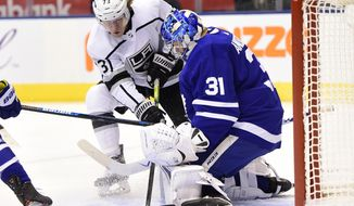 Toronto Maple Leafs goaltender Frederik Andersen (31) stops Los Angeles Kings centre Tyler Toffoli (73) during first period NHL hockey action in Toronto on Tuesday, Nov. 5, 2019. (Frank Gunn/The Canadian Press via AP)