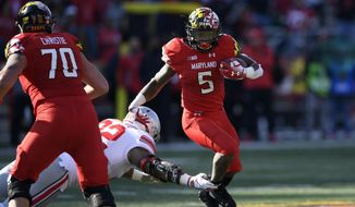 In this Nov. 17, 2018, file photo, Maryland running back Anthony McFarland (5) runs the ball against Ohio State defensive tackle Haskell Garrett (92) during the first half of an NCAA football game, in College Park, Md. One year ago, Maryland took Ohio State into overtime before a failed 2-point conversion resulted in a 52-51 defeat. McFarland Jr. enjoyed the finest day of his career in that back-and-forth duel with the then-No.9 Buckeyes. In the rematch Saturday, the Terrapins are a 43-point underdog. (AP Photo/Nick Wass) ** FILE **