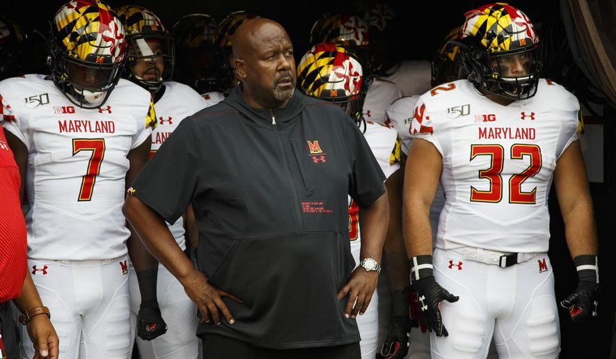 In this Sept. 14, 2019, file photo, Maryland head coach Michael Locksley, center, looks on as he is about to lead his team out of the tunnel for the first half of an NCAA college football against Temple, in Philadelphia. One year ago, Maryland took Ohio State into overtime before a failed 2-point conversion resulted in a 52-51 defeat. In the rematch Saturday, the Terrapins are a 43-point underdog. (AP Photo/Chris Szagola) ** FILE **