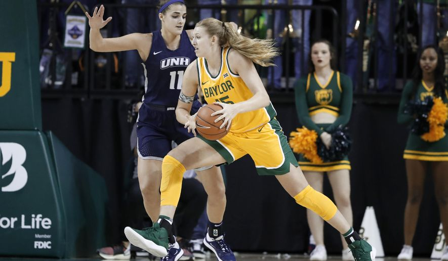 New Hampshire's Ashley Storey (11) defends as Baylor's Lauren Cox (15) works to the basket for a shot in the first half of an NCAA college basketball game in Waco, Texas, Tuesday, Nov. 5, 2019. (AP Photo/Tony Gutierrez)