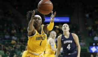 Baylor forward NaLyssa Smith (1) reaches out for a loose ball in front of New Hampshire's Ivy Gogolin (4) in the first half of an NCAA college basketball game in Waco, Texas, Tuesday, Nov. 5, 2019. (AP Photo/Tony Gutierrez)