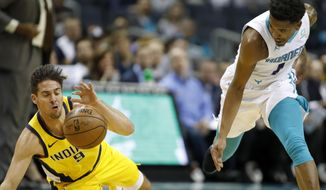 Indiana Pacers' T.J. McConnell (9) recovers a loose ball away from Charlotte Hornets' Malik Monk (1) during the first half of an NBA basketball game in Charlotte, N.C., Tuesday, Nov. 5, 2019. (AP Photo/Bob Leverone)