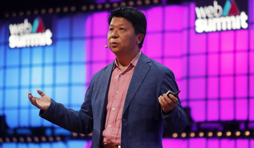 Huawei Rotating Chairman Guo Ping addresses attendees at the Web Summit technology conference in Lisbon, Monday, Nov. 4, 2019.  (AP Photo/Armando Franca)